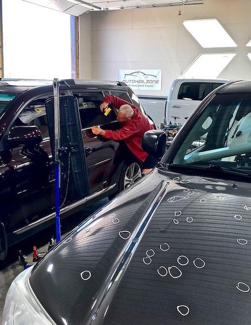 Technician repairing door
