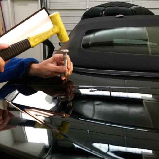 Technician repairing car body